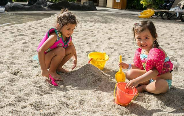 kids playing beach sand