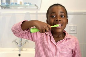 Girl-brushing-teeth