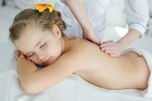 a little girl relaxed with a massage