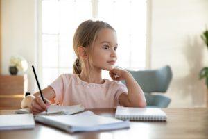 little girl not focusing on homework