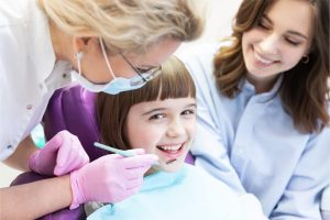 young girl with dentist