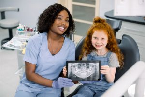 female dentist and patient